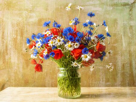colorful still life: Still life with bouquet of colorful wild flowers Stock Photo