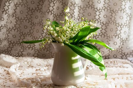 lily of the valley: still life with a bouquet of lily of the valley Stock Photo