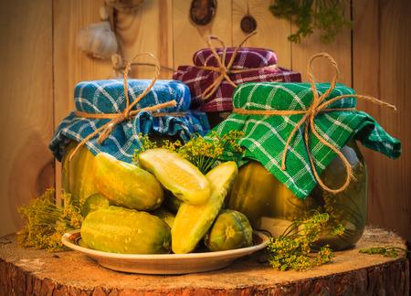 gherkins: Jars of pickled gherkins on a wooden table