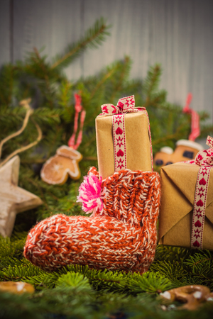 christmas grounds: Christmas gifts in handsewn socks. Christmas decorations in the branches of spruce