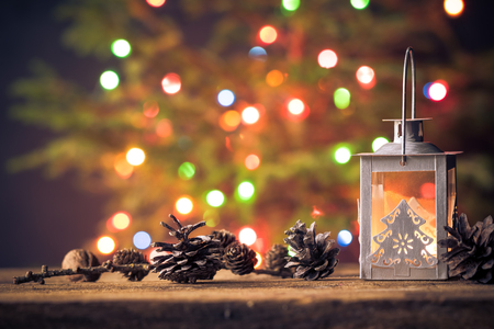 Christmas card: wooden table with cone and lantern