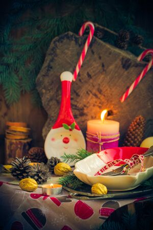 festively: Festively decorated Christmas table: tableware, candles, all in the Christmas mood Stock Photo