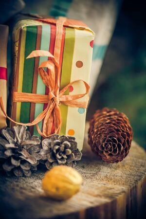 christmas grounds: What brought Santa Claus: Christmas gifts, packets, cones on a wooden table.