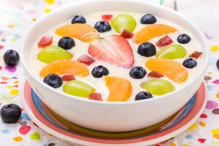 vanilla pudding: A delicious milky vanilla pudding with colorful fruit
