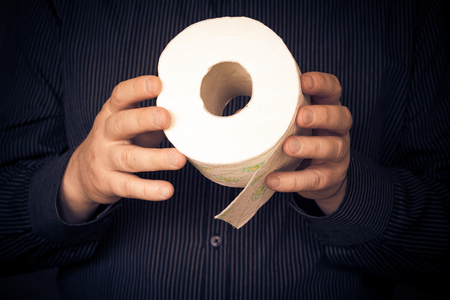 fecal: Man with a roll of toilet paper. Stock Photo