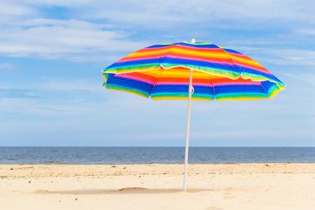 Colorful sunshade on a sunny beach.