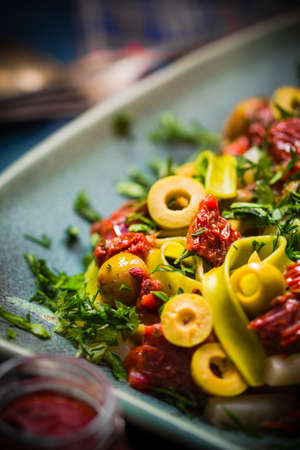 alcaparras: Pasta with tomato sauce, capers and asparagus. Magic light
