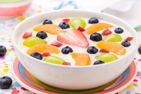 vanilla pudding: Colorful spring dessert: vanilla pudding with fruit