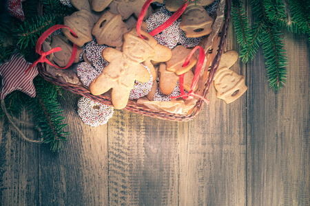 A Christmas basket full of dumplings. Sweet cookies on a wooden table. Space for text Standard-Bild