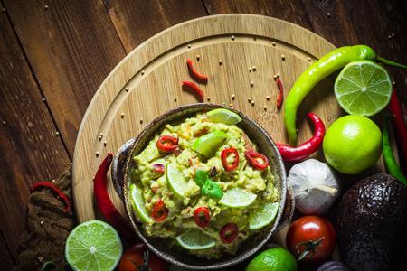 Delicious dip: avocado paste with tomato, chilli pepper, lime, onion, garlic, dill and coriander