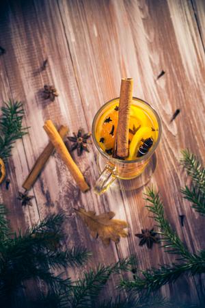 Delicious medicinal tea with lemon, orange, cinnamon and cloves for winter evenings Standard-Bild