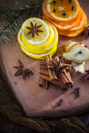Citrus and spices. Lemon, orange, cloves, cinnamon, ginger. Ingredients for medicinal tea