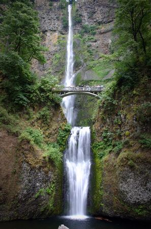A double waterfall with a bridge for spectators photo