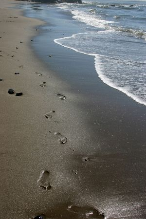 The footprints left in the sand on the beach Stock Photo - 3377472