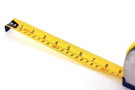 A measuring tape that is outstreched to show its numbers