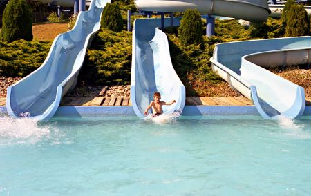 Boy having fun on the water slides Stock Photo