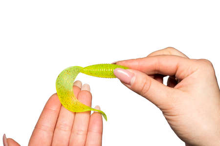 Green Silicone bait for fishing in female hands photo