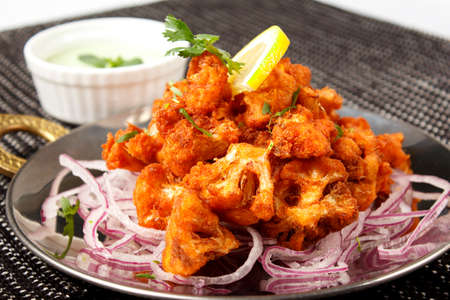 Cauliflower in battered onion with pickled onion