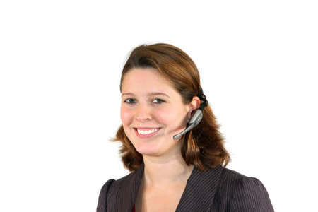 acquisitions: a smiling beautiful female call center agent with a headset, isolated on white background