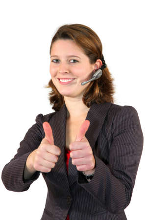 a smiling beautiful female call center agent with a headset posing with the thumbs up sign, isolated on white background photo