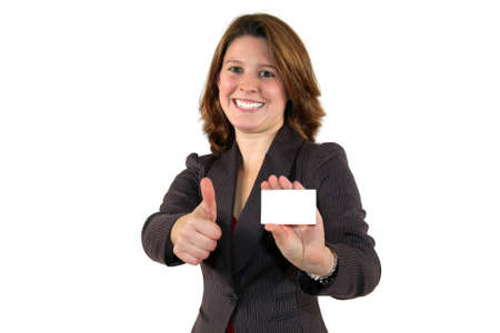 a smiling beautiful young business woman showing a business card with copy space and posing with the thumbs up sign, isolated on white background photo