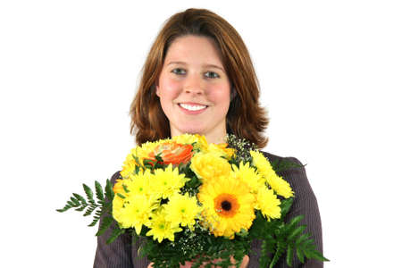a smiling beautiful young business woman with a bunch of flowers, isolated on white background photo