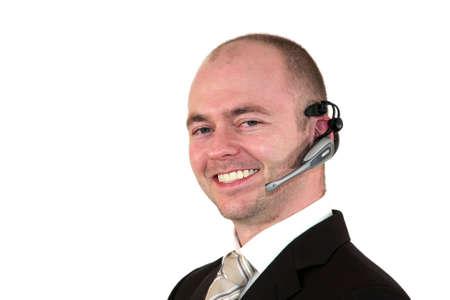 call center agent: un agente di centro di chiamata maschio sorridente con un auricolare, isolato su sfondo bianco