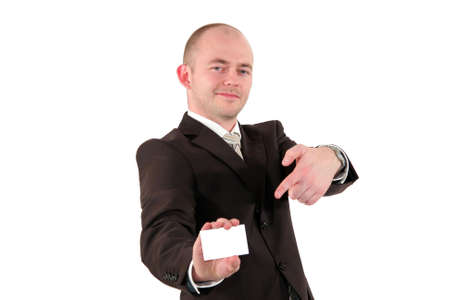 a smiling young business man pointing at a business card with copy space, isolated on white background photo