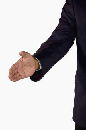 reached: A hand of a senior African-American businessman reached out for a welcoming handshake, isolated on white background