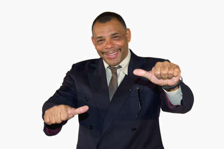 A smiling senior African-American businessman posing with both thumbs up, isolated on white background Stock Photo - 6473390