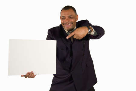 A smiling senior African-American businessman pointing at a picture board with copy space, isolated on white background Stock Photo - 6473344