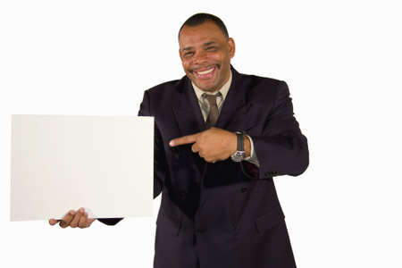 A smiling senior African-American businessman pointing at a picture board with copy space, isolated on white background Stock Photo - 6473346