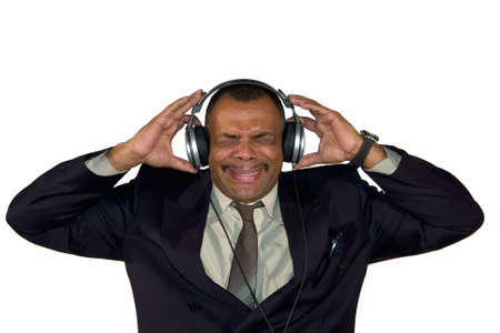 a mature Arfrican-American man with headphones listening to bad sound and making faces, isolated on white background Stock Photo - 6473503