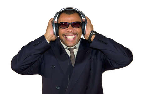 a mature Arfrican-American man with headphones listening to bad sound and making faces, isolated on white background Stock Photo - 6473594