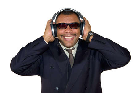 a smiling mature Arfrican-American man with headphones and sunglasses, isolated on white background Stock Photo - 6473592