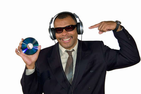 a smiling mature African-American man pointing at an audio CD, isolated on white background Stock Photo - 6473588