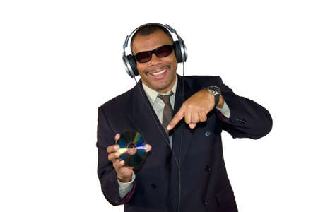 a smiling mature African-American man pointing at an audio CD, isolated on white background photo