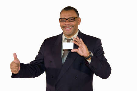 a smiling mature African-American businessman showing a business card with copy space and posing thumbs up, isolated on white background photo