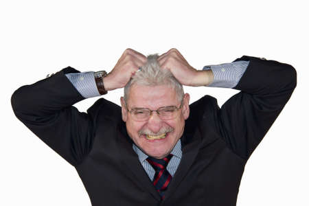 a caucasian senior manager freaking out and tearing his hear, isolated on white background