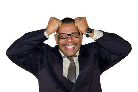 freaking: a mature African-American freaking out and tearing his hair, isolated on white background