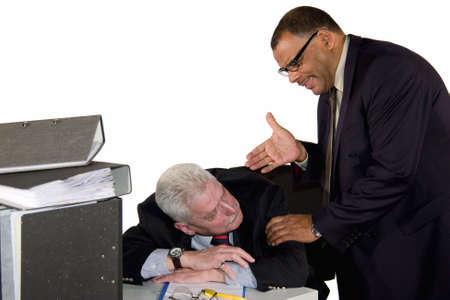 a caucasian senior businessman being caught by his boss while sleeping during office hours, isolated on white background photo