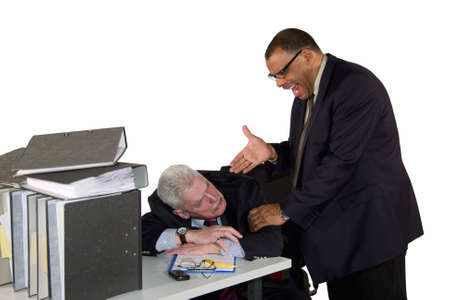 a caucasian senior businessman being caught by his angry and yelling boss while sleeping during office hours, isolated on white background photo
