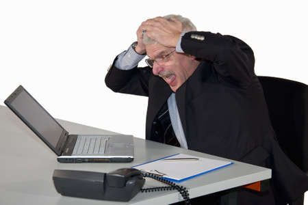 freaking: a caucasian senior manager receiving bad news and freaking out, isolated on white background