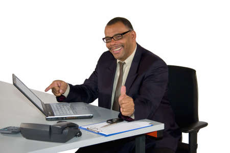a smiling mature African-American businessman posing with thumbs up, isolated on white background Standard-Bild