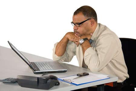 a concentrated mature African-American businessman receiving bad news, isolated on white background photo