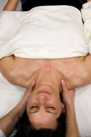 hardening: a natural mature woman having a massage at her neck and shoulder muscles