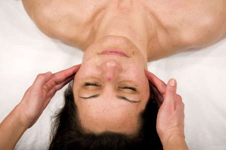 jaw: a natural mature woman having a massage at her masseters Stock Photo