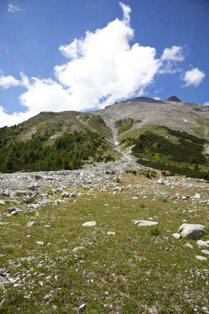high plateau: A high plateau in the Alps in South Tirol, photographed in the summer with blue sky and clouds in the background