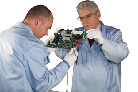 IT - engineers inspecting a motherboard Stock Photo