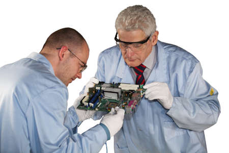 IT - engineers inspecting a motherboard photo